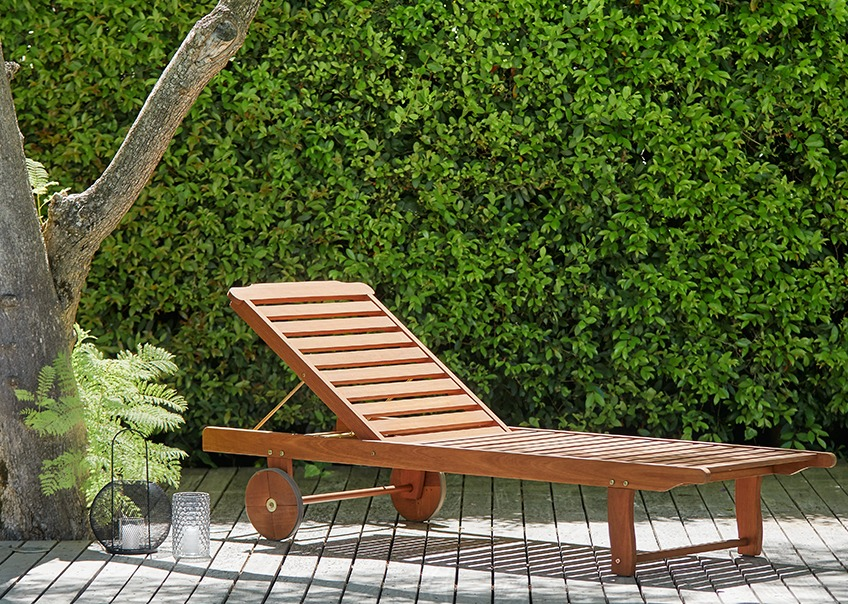 Wooden sun lounger on a patio