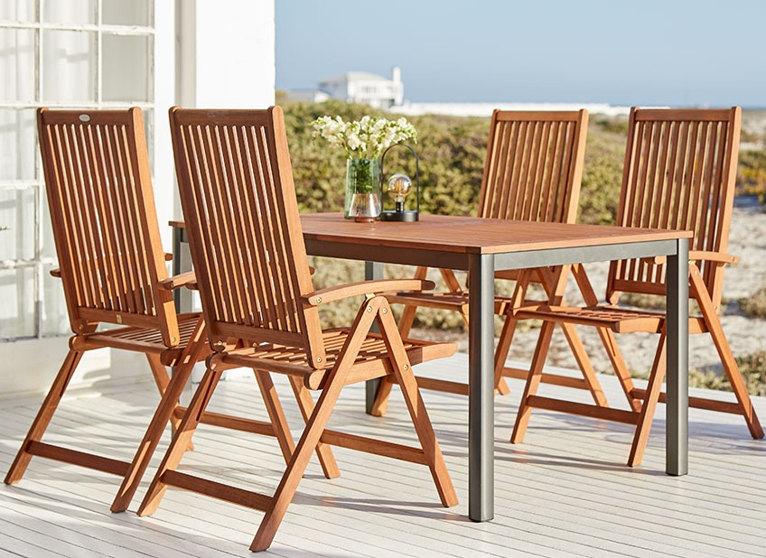 Wooden garden furniture on a patio by the ocean