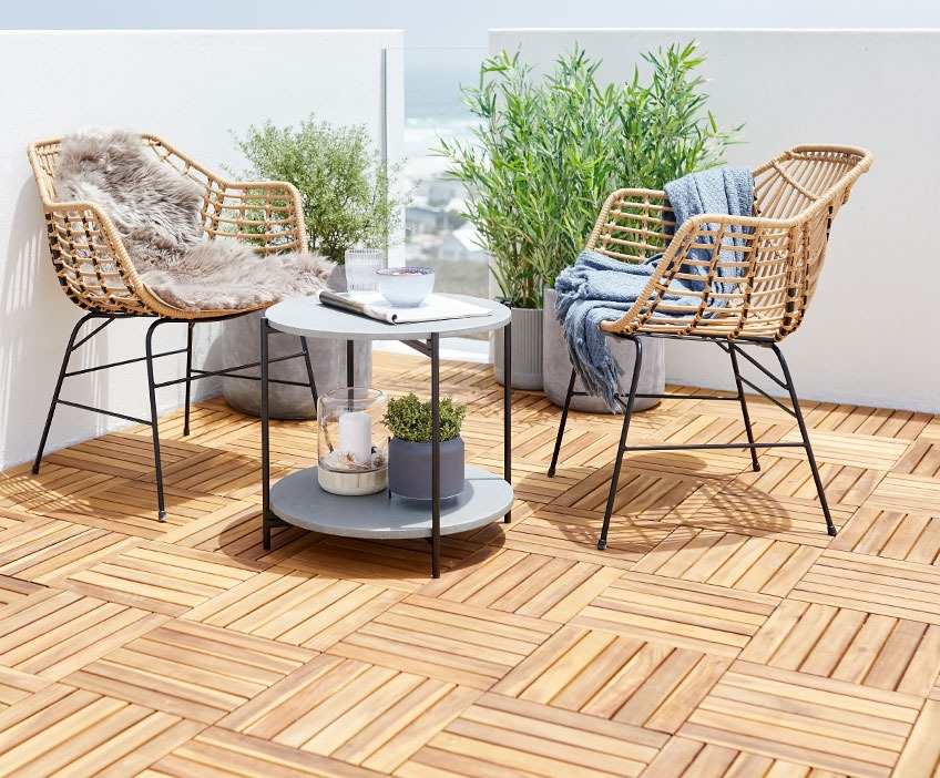 Lounge chairs and a lounge table on a patio with wooden deck tiles