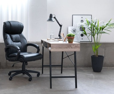 black faux leather office and desk chair