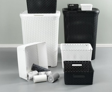 White and black plastic storage boxes