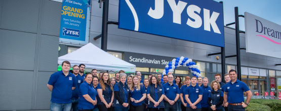 JYSK employees stood in blue polo uniform outside of store