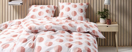 Duvet cover set white with coral and peach circle design wooden oak bedside table