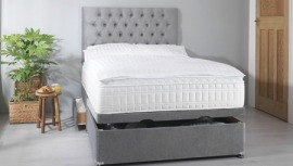 Luxury spring mattress on a grey divan base