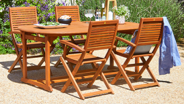 Wooden garden table and chairs in an outdoor space