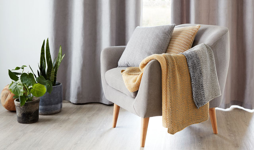 Cosy armchair with throws and cushions