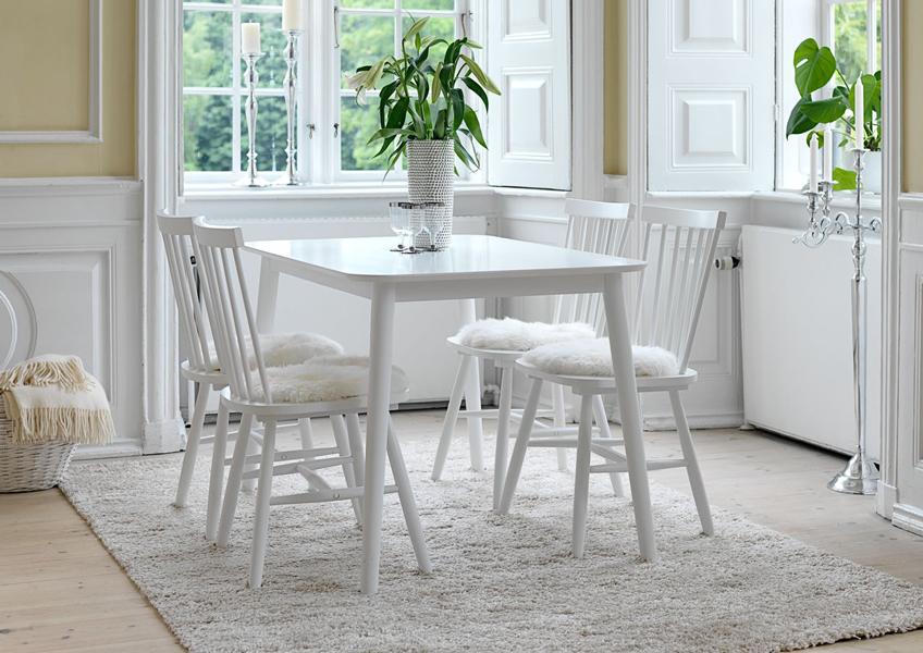 white dining chairs and white dining table from JYSK