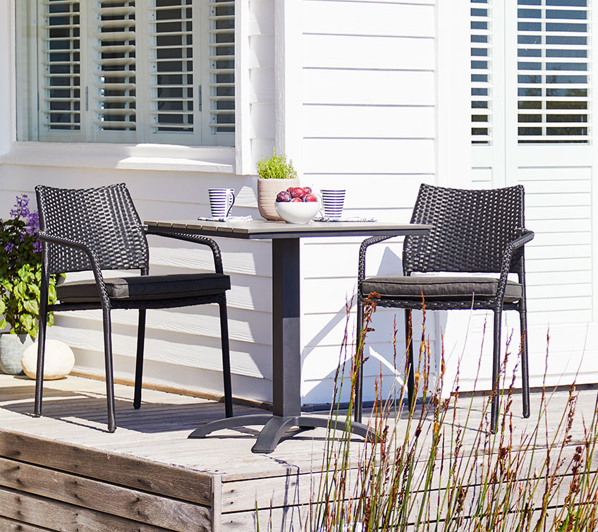 Relax on your patio with a patio table and chairs