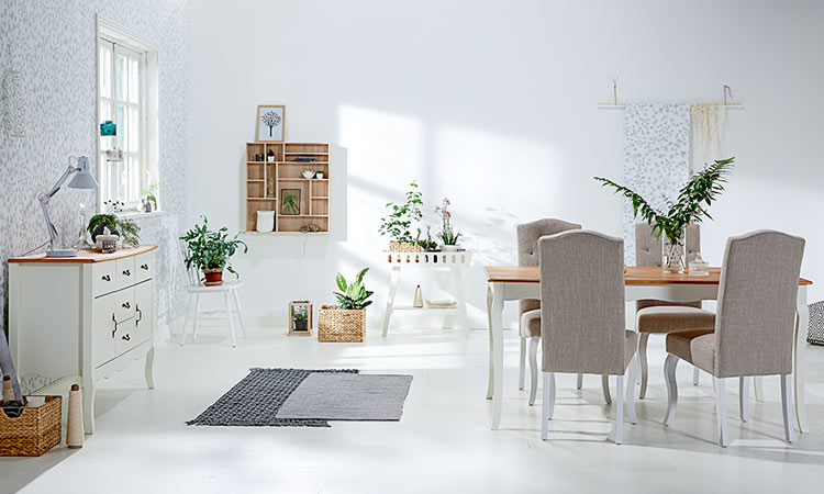 White dining table and fabric dining chairs with JYSK