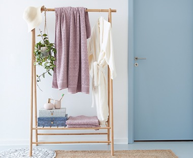 Create true Scandinavian vibes with a wooden clothes rail