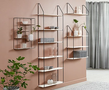 A series of wall shelves with metal wire frame and wooden shelves