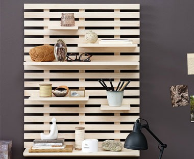 A wooden slatted wall shelf with adjustable shelving heights